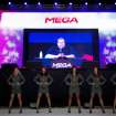 Indicted Megaupload founder Kim Dotcom appears on a large screen during the launch of a new file-sharing website called