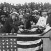 In this Oct. 1924 photo provided by the Library of Congress, Washington Senators' Stanley Harris, at right in the grandstand, presents President Calvin Coolidge with the baseball used to open the 1924 World Series in Washington. Like this year's Washington Nationals, the 1924 World Series champion Washington Senators generated excitement in a city starved for a baseball winner. The Nats will begin their quest for the city's second championship when the playoffs begin this weekend.(AP Photo/Library of Congress)