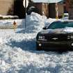The low clearance of this  sports car caused it to become stuck in deep snow on a residential street near Reno and Air Depot in Midwest City Thursday, Feb. 3, 2011.   Photo by Jim Beckel, The Oklahoman