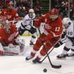 Detroit Red Wings center Pavel Datsyuk (13), of Russia, controls the puck in front of Los Angeles Kings center Mike Richards (10) during the first period of an NHL hockey game in Detroit, Wednesday, April 24, 2013. (AP Photo/Carlos Osorio)