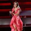 Host Carrie Underwood speaks on stage at the 47th annual CMA Awards at Bridgestone Arena on Wednesday, Nov. 6, 2013, in Nashville, Tenn. (Photo by Wade Payne/Invision/AP)