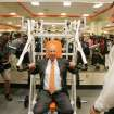 COLLEGE FOOTBALL / OSU: Oklahoma State University's strength and conditioning coach Rob Glass watches as T. Boone Pickens uses a weight machine during a tour of the west end zone of Boone Pickens Stadium's facilities in Stillwater, Oklahoma August 17, 2009. Photo by Steve Gooch, The Oklahoman ORG XMIT: KOD