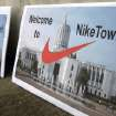 Signs protesting emergency legislation requested by apparel giant Nike Inc., greet visitors arriving at the Oregon state Capitol in Salem, Ore., on Friday, Dec. 14, 2012. The Legislature is considering a tax deal requested by Nike in exchange for bringing hundreds of new jobs to Oregon. (AP Photo/Jonathan J. Cooper)
