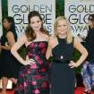 Tina Fey, left, and Amy Poehler arrive at the 71st annual Golden Globe Awards at the Beverly Hilton Hotel on Sunday, Jan. 12, 2014, in Beverly Hills, Calif. (Photo by John Shearer/Invision/AP)