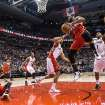 Washington Wizards' Trevor Booker, center right, takes a pass from the grounded John Wall, left, in front of the Toronto Raptors defense during first half NBA basketball action in Toronto, Thursday, Feb. 27, 2014. (AP Photo/The Canadian Press, Chris Young)