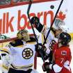Boston Bruins goaltender Anton Khudobin (35) watches as David Krejci (46) and Ottawa Senators' Kyle Turris (7) try for possession of the puck during the first period of their NHL hockey game, Thursday, March 21, 2013, in Ottawa, Ontario. (AP Photo/The Canadian Press, Fred Chartrand)