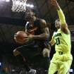 Oklahoma State forward Brian Williams (4) drives past Baylor center Isaiah Austin (21), right, in the first half of an NCAA college basketball game, Monday, Feb. 17, 2014, in Waco, Texas. (AP Photo/Waco Tribune Herald, Rod Aydelotte)