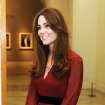 The Duchess of Cambridge smiles after viewing her newly-commissioned portrait by artist Paul Emsley at the National Portrait Gallery in central London, Friday Jan. 11, 2013. (AP Photo/John Stillwell, Pool)