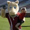 Javi Restrepo poses with one of the OU mascots during the multi-sport morning the OU athletic department organized for him.- Photo provided ORG XMIT: 0908122159547863