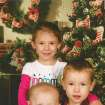 Above: Siblings Destiny Brown-Jones, John Brown-Jones II and Dylan Terry in 2010. The two boys died in a Midwest City apartment fire.