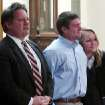 Former University of Montana quarterback, Jordan Johnson, center, reacts to being acquitted of rape charges during his trial Friday March 1, 2013 in Missoula, Mont. With Johnson are his attorneys, David Paoli and Kirsten Pabst. The accusations against Johnson, 20, have drawn much attention in Montana, where UM football is the top sports attraction. Jurors deliberated for less than two hours. (AP Photo/Matt Gouras)