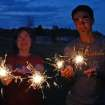 Cousins, Emily Tennison and Evan Mathew, show off their sparklers.  Community Photo By:  Cindi Tennison  Submitted By:  Cindi , Bethany