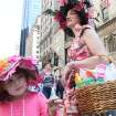 Julia Scott, 4, of Fairlawn, N.J., left, and her mother Regina Scotti, right, take part in the Easter Parade along New York's Fifth Avenue Sunday April 24, 2011. (AP Photo/Tina Fineberg)