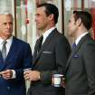 This publicity image released by AMC shows John Slattery as Roger Sterling, left, Jon Hamm as Don Draper, center, and Vincent Kartheiser as Pete Campbell in a scene from the season six premiere of
