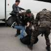 In this photo taken Wednesday, May 14, 2014  a person identified by Turkish media as Yusuf Yerkel, advisor to Turkish Prime Minister Recep Tayyip Erdogan, kicks a protester already held by special forces police members during Erdogan's visiting  Soma, Turkey. Erdogan was visiting the western Turkish mining town of Soma after Turkey's worst mining accident . AP Photo/Depo Photos) TURKEY OUT  ONLINE OUT