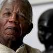 FILE - Chinua Achebe, Nigerian-born novelist and poet poses his life at his home on the campus of Bard College in Annandale-on-Hudson, New York where he is a professor in this Jan. 22, 2008 file photo. Achebe, who wrote the classic