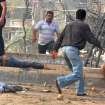 In this photo released by the Syrian official news agency SANA, men run between dead and injured people at the scene where two bombs exploded in the Qazaz neighborhood in Damascus, Syria, Thursday, May 10, 2012. Two large explosions ripped through the Syrian capital Thursday, heavily damaging a military intelligence building and leaving blood and human remains in the streets. (AP Photo/SANA) ORG XMIT: BEI109