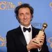 "Paolo Sorrentino poses in the press room with the award for best foreign language film for ""The Great Beauty"" at the 71st annual Golden Globe Awards at the Beverly Hilton Hotel on Sunday, Jan. 12, 2014, in Beverly Hills, Calif. (Photo by Jordan Strauss/Invision/AP)"
