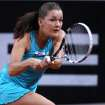 Poland's Agnieszka Radwanska hits a backhand against China's Li Na during their quarterfinal match at the Porsche tennis Grand Prix in Stuttgart, Germany, Friday, April 27, 2012. Radwanska won 3-6, 6-2 and 6-3. (AP Photo/Michael Probst) ORG XMIT: PSTU106