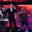 Robin Thicke, center, performs on stage with Peter Cetera, left, and Robert Lamm, right, of Chicago at the 56th annual GRAMMY Awards at Staples Center on Sunday, Jan. 26, 2014, in Los Angeles. (Photo by Matt Sayles/Invision/AP)