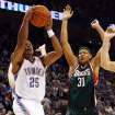 Earl Watson (25) of the Thunder scores the first basket past Charlie Villanueva (31) of the Bucks during the NBA basketball game between the Oklahoma City Thunder and the Milwaukee Bucks at the Ford Center in Oklahoma City, Wednesday, Oct. 29, 2008. This was the regular season debut of the Thunder. BY NATE BILLINGS, THE OKLAHOMAN