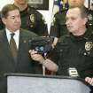 CHRISTMAS SHOPPING ALERT / WARNING: Attorney General Drew Edmondson and Oklahoma County Sheriff John Whetsel warn holiday shoppers to protect themselves against financial fraud and old-fashioned theft during a press conference in Oklahoma City, Okla. November 25, 2008. Sheriff  Whetsel is holding a fanny pack and suggested women wear the packs instead of carrying a purse.   BY STEVE GOOCH, THE  OKLAHOMAN.  ORG XMIT: KOD
