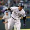 Colorado Rockies' Troy Tulowitzki circles the bases after hitting a solo home run against the San Diego Padres in the first inning of a baseball game in Denver on Saturday, May 17, 2014. (AP Photo/David Zalubowski)