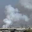 In this image taken from video obtained from the Shaam News Network, which has been authenticated based on its contents and other AP reporting, smoke rises from buildings due to shelling in Damascus, Syria, on Thursday, March 28, 2013. (AP Photo/Shaam News Network via AP video)
