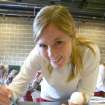 University of Oklahoma women's soccer team member Ashley Farrand is painting a nose on one of 50 Dalmatian puppy cutouts at the J. D. McCarty Center. Farrand, a sophomore midfielder from Jenks, Oklahoma, was one of 18 OU soccer players who volunteered to work on this 101 Dalmatian Christmas project for the McCarty Center. The J. D. McCarty Center is a pediatric rehab hospital for children with developmental disabilities in Norman.  Community Photo By:  Greg Gaston  Submitted By:  Greg, Norman