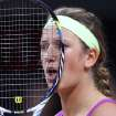 Belarus' Victoria Azarenka looks through her racket  during her quarterfinal match against German Mona Barthel at the Porsche tennis Grand Prix in Stuttgart, Germany, Friday, April 27, 2012. (AP Photo/Michael Probst) ORG XMIT: PSTU112