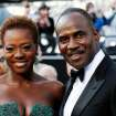 Viola Davis, left, and Julius Tennon arrive before the 84th Academy Awards on Sunday, Feb. 26, 2012, in the Hollywood section of Los Angeles. (AP Photo/Matt Sayles) ORG XMIT: OSC149