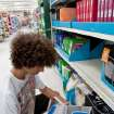 Jonah Widmer ,16, looks for a binder in the school supplies section. Students shop for school supplies at Walmart in Oklahoma City, Okla on Tuesday June 20, 2010. Photo by Mitchell Alcala, The Oklahoman