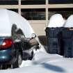 Nearly two feet of snow is piled on  this car parked in front of a tire business on NE 23 east of MLK Thursday, Feb. 3, 2011.   Photo by Jim Beckel, The Oklahoman