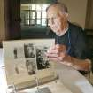 Jack Ball of Kansas City, MO looks at a scrapbook as he joined other members of the 780th Bomber Squadron during a reunion in Midwest City, Oklahoma September 2, 2009. Photo by Steve Gooch, The Oklahoman
