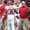 Oklahoma coach Bob Stoops celebrates with Javon Harris after Harris intercepted a Texas Tech pass and scored a touchdown during an NCAA college football game in Lubbock, Texas, Saturday, Oct. 6, 2012. (AP Photo/Lubbock Avalanche-Journal, Stephen Spillman) LOCAL TV OUT