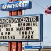 A sign telling residents about a memorial service is posted at the Convention Center in Hawthorne, Nev., near the Hawthorne Army Depot on Tuesday, March 19, 2013, where seven Marines were killed and several others seriously injured in a training accident Monday night, about 150 miles southeast of Reno in Nevada's high desert. (AP Photo/Scott Sonner)