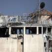 This picture shows the destroyed rooftop of the media complex that houses the offices of Hamas-run Al Aqsa television and radio after it was targeted in an Israeli strike in central Gaza City early on Tuesday, July 29, 2014. Israeli aircraft, tanks and navy gunboats pounded symbols of Hamas control in Gaza City in the heaviest night of bombardment in three weeks of Israel-Hamas fighting. (AP Photo/Khalil Hamra)