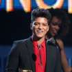 "Bruno Mars accepts the award for best pop vocal album for ""Unorthodox Jukebox"" at the 56th annual Grammy Awards at Staples Center on Sunday, Jan. 26, 2014, in Los Angeles. (Photo by Matt Sayles/Invision/AP)"