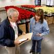Lynn Haynes, executive director of Meals on Wheels, right, helps volunteer Gene Groff load poinsettias for delivery in Norman, Oklahoma on Wednesday, December 5, 2007.  Photo By STEVE SISNEY, The Oklahoman