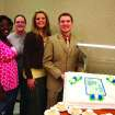 Oklahoma City University Student Publications staffers Najah Hylton, Alaina Stevens, Dusty Reasons and Editor Nathan Altadonna celebrate the centennial issue of The Campus newspaper by serving cake to students, faculty and staff in the university's cafeteria Wednesday. The Campus staff produced a 28-page insert to today's newspaper to mark the publication's 100th birthday.  Community Photo By:  Leslie Berger/OCU News Services  Submitted By:  Leslie, Oklahoma City