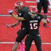 Eastern Washington's Ashton Clark (15) celebrates a touchdown against North Dakota during the first half of an NCAA college football game on Saturday, Oct. 6, 2012, at Roos Field in Cheney, Wash. (AP Photo/The Spokesman-Review, Tyler Tjomsland) COEUR D'ALENE PRESS OUT
