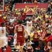 Oklahoma guard Buddy Hield, right, puts up a shot over Iowa State guard DeAndre Kane (50) during the first half of an NCAA college basketball game in Ames, Iowa, Saturday, Feb. 1, 2014. (AP Photo/Justin Hayworth)