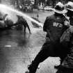 FILE - In this July 15, 1963 file photo, firefighters aim their hoses on civil rights demonstrators in Birmingham, Ala. 1963 was a year of revolution in race relations in the United States. (AP Photo/Bill Hudson, File)
