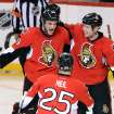Ottawa Senators' Dave Dziurzynski celebrates his second-period goal with Chris Neil (25) and Zack Smith (15) during their NHL hockey game against the Montreal Canadiens, Monday, Feb. 25, 2013, in Ottawa, Ontario. (AP Photo/The Canadian Press, Sean Kilpatrick)