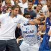 Greek center Sofoklis Schortsanitis, center, tries to kick Serb center Nenad Krstic, of the NBA's Oklahoma City Thunder, right, as Greek center Yannis Bouroussis, who did not take part in the game, tries to stop them during a basketball game for the Acropolis tournament at the indoor Olympic stadium of Athens, Thursday, Aug. 19, 2010.The friendly Acropolis basketball tournament never finished as the last game, between Serbia and Greece, was abandoned with 2:40 to go when a fight broke out and the benches cleared. (AP Photo/Newsports, Nikos Chalkiopoulos)