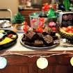 """Island-themed decorations and food are displayed during a """"Lost"""" series finale watch party at the Moore home of Alex and Amber Gates.  Photo by John Clanton, The Oklahoman"""