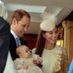 Britain's Prince William, Kate Duchess of Cambridge with their son Prince George arrive at the Chapel Royal in St James's Palace in London, for the christening of the three month-old Prince George, Wednesday Oct. 23, 2013.  The 3-month-old future monarch, Prince George will be christened Wednesday with water from the River Jordan at a rare four-generation gathering of the royal family in London. (AP Photo/John Stillwell/Pool)
