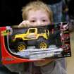 John Moore, a kindergarten student at Santa Fe South, shows off a remote controlled toy he received during the annual Christmas Party and gift exchange at Santa Fe South High School in OKlahoma City on Friday, Dec. 3, 2010. Photo by John Clanton, The Oklahoman