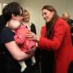 FILE - In this Friday, April 5, 2013, Kate, the Duchess of Cambridge, right, talks to members of the crew and their families as she visits the Astute-class Submarine Building at BAE Systems in Barrow-in-Furness, England.  Prince William's wife Kate has been admitted to the hospital in early stages of labor it was announced on Monday July 22, 2013. (AP Photo/Chris Jackson, Pool-File)