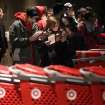 Matt Alcover (left) and Rebecca Hoyland (right) take a look at a map of Target as they wait in line before its opening at 9 p.m. as shoppers took advantage of the sales and deals in the earlier shopping period for the typical